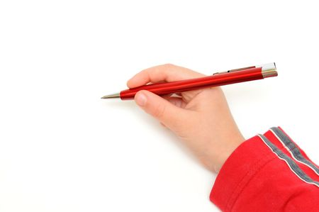 Hand holding red pen on the paper.