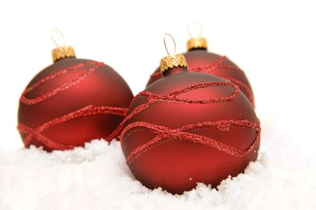 Three red glass balls on the snow. Stock Photo - 3999211