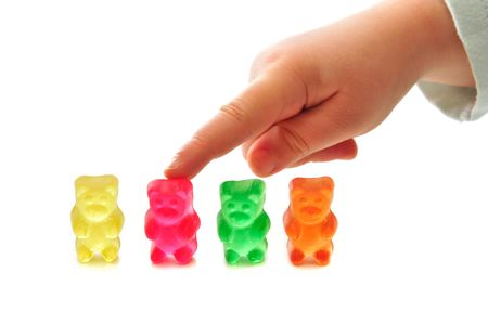 favorite colour: Foyr of colorfoul gummy bears on white background Stock Photo