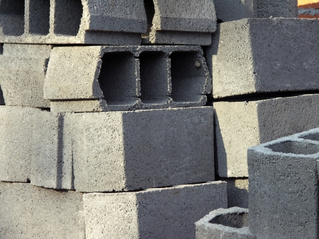 Pile of arranged new hollow bricks on the site photo