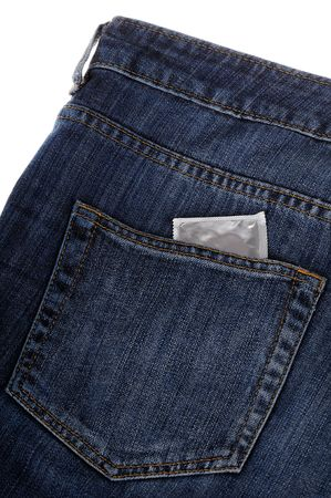 Condom in a back pocket of denim trousers. photo