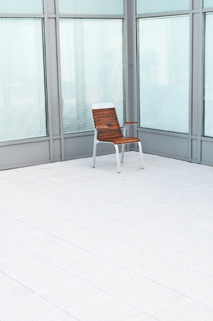 Single wooden chair in a bright empty room. photo