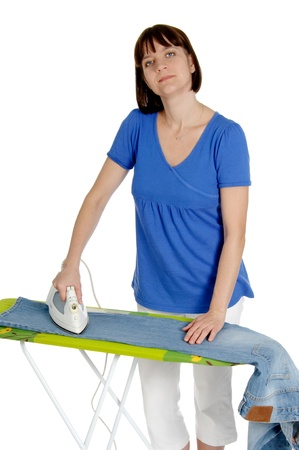 domestic scene: Ironing trousers woman isolated on white background. Stock Photo