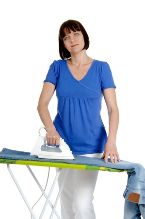 everyday people: Ironing trousers woman isolated on white background. Stock Photo