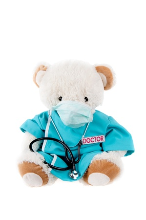 Teddy bear as a doctor with stethoscope. photo