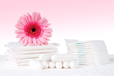 Health care and medicine - tampons and pads on pink background. photo