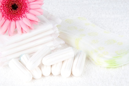 tampon: Health care and medicine - tampons and pads on towel  background.