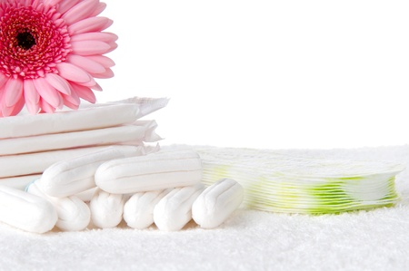 menses: Health care and medicine - tampons and pads on background.