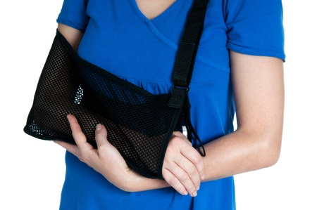 Woman with broken arm in sling on white backgroundt. Stock Photo