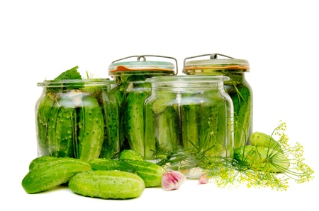 Preparing of pickled cucumbers in jars.