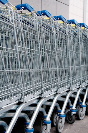 A line of shopping carts against supermarket. Stock Photo - 10294250