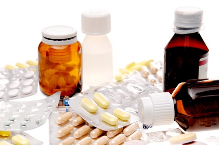 Different types of drugs on white background