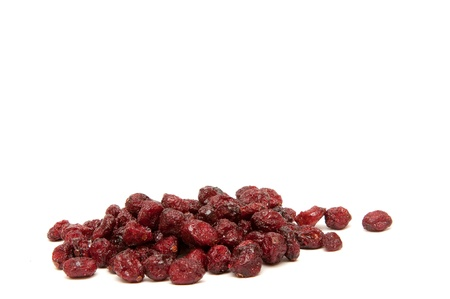 Dried cranberries on a white background.