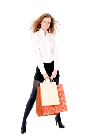 Young woman carrying shopping bags isolated on the white background Stock Photo - 11310084