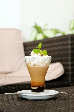 Coffee in glass with whipped cream  photo