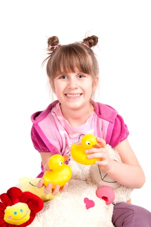 Little girl and her toys  Isolated on white   photo