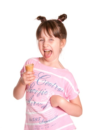 Little girl eating an ice cream isolated on white  photo
