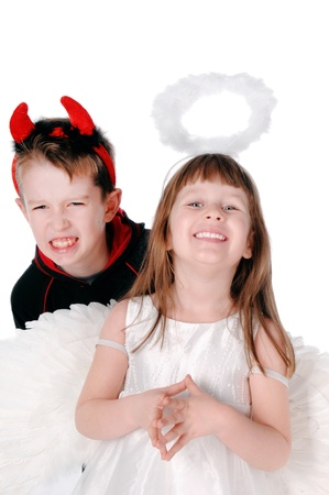 antithesis: Brothers and sisters an angel and devil Stock Photo