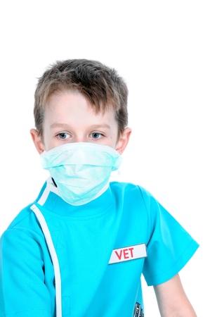 Boy playing the veterinary surgeon Stock Photo - 14188746