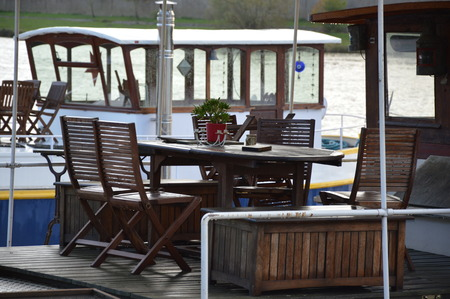 dining table and chairs: Dining table and chairs on a houseboat Stock Photo
