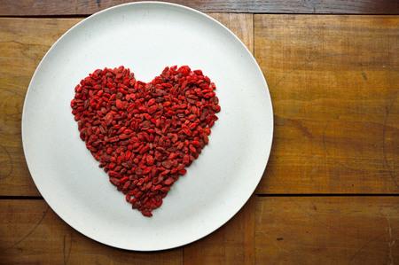 Heart made of goji berries photo