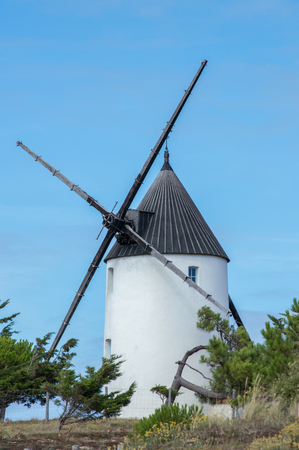 wind powered building: Round white wooden windmill with a black roof