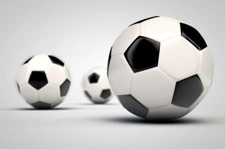 Three soccer balls. Selective focus. Stock Photo