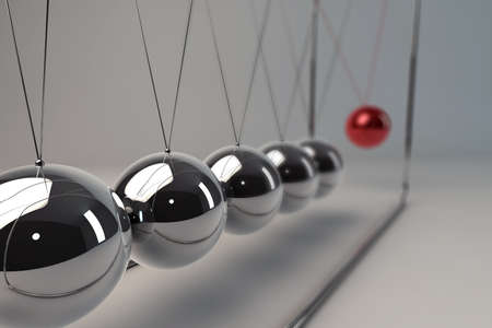 Chrome balancing spheres know as Newtons Cradle (pendulum) photo
