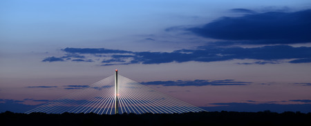 Night time photo of a bridge and blue sky