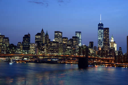 Evening view of New York famous bridge and district photo