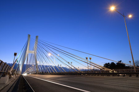 Evening photo of blue sky over a modern bridge Stock Photo