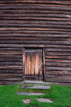 The wooden wall and door. Wood texture or background