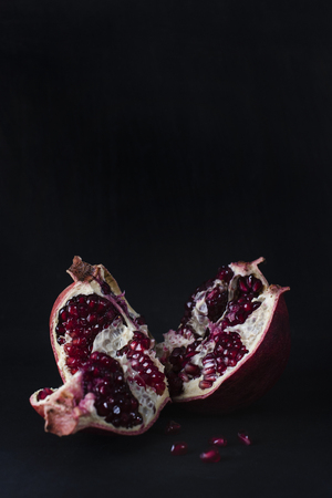 Fruit of the pomegranate with juicy seeds on the inside.