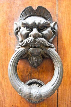 Old metal door handle knocker knob angry head Stock Photo - 3899822