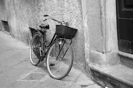 Old bicycle on street black and white Stock Photo