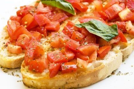 Fresh bruschetta with tomato and basil photo