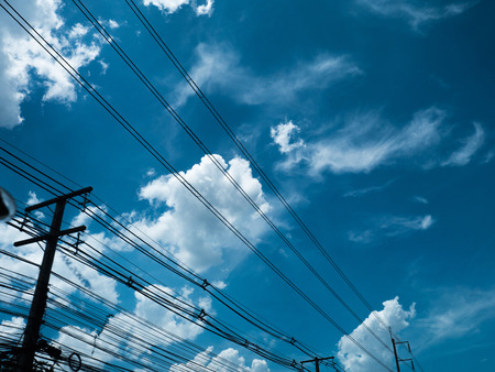 electric pole power lines and wires with blue sky with lamp
