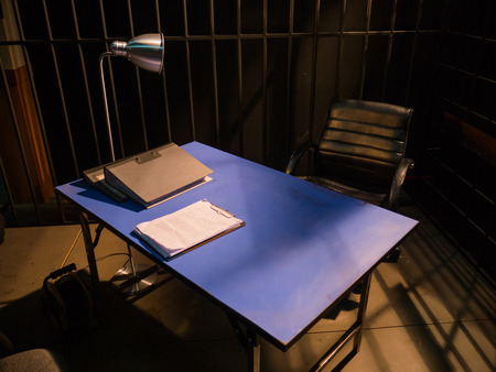 interrogation: Dark Interrogation Room with Chairs and Table a disturbing Situation