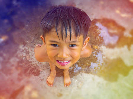 Cute outdoor portrait of happy smiling Asian Thai little boy