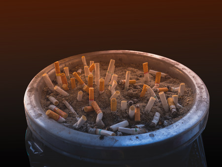 smoked cigarettes in a dirty ashtray