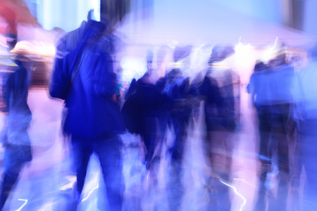 unrecognizable: people walking in modern office, abstract blurred motion