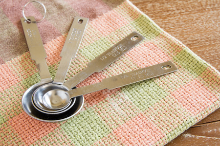 measuring spoons: measuring spoons on cloth and table