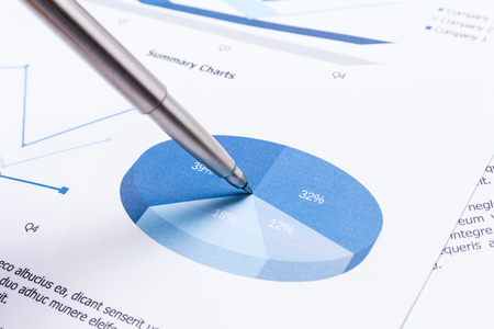 business performance: business report on table, business performance concept