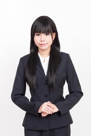 mujer trabajadora: Mujer de negocios asi�tica aislada sobre fondo blanco Foto de archivo