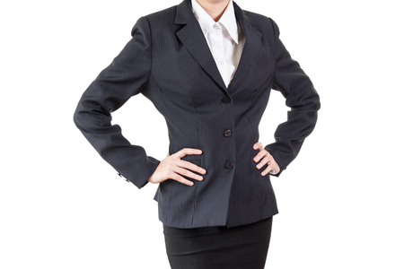 akimbo: business woman with arms akimbo isolated on white background Stock Photo