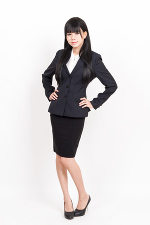 akimbo: asian business woman with arms akimbo isolated on white background