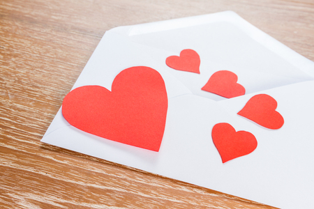 cover background time: love letter envelope with red heart on wooden background Stock Photo