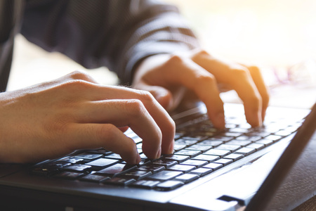 hand using mobile laptop computer, closeup view