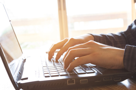 business man using laptop computer on office desk