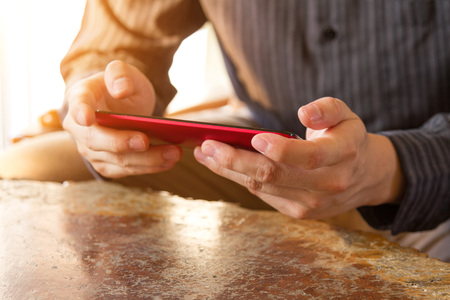 business people using mobile phone on wooden desk